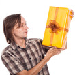 Surprised man with present