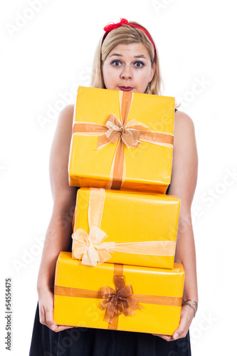 Surprised woman carrying presents
