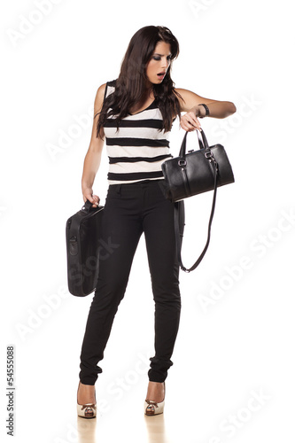 business woman with her  laptop bag  looks at her wrist watch
