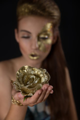 Beautiful girl blows on roses