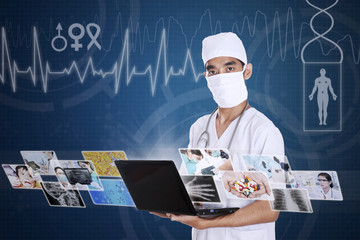 Doctor looking at digital picture on laptop