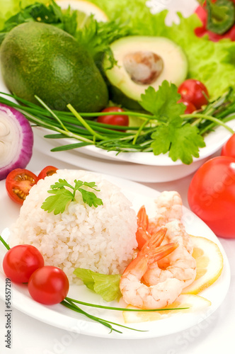 healthy food background: boiled rice, vegetables and prawns