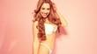 Sexy brunette woman in lingerie dancing in the studio