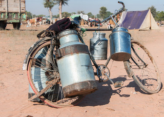 Bike with milk canisters on its side at Nagaur's cattle fair in