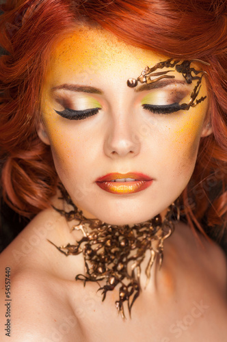 beauty shot of beautiful woman wearing professional make-up on