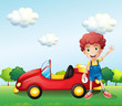 A boy waving his hand beside a car