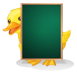 A duckling holding a blackboard