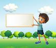 A boy holding an empty framed board