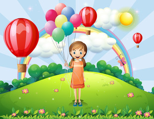 A girl holding balloons