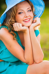 happy blonde woman wearing hat