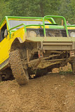 Yellow off-road car leaves steep slope