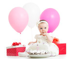 baby girl with cake, balloons and gifts isolated on white