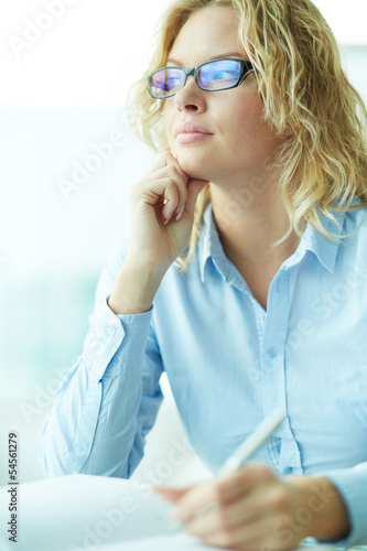 Pensive businesswoman