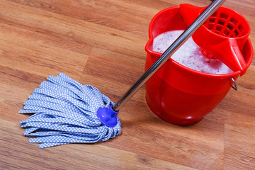 blue textile mop and red bucket