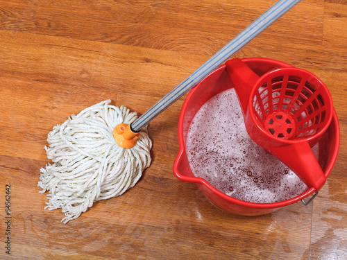textile mop and red bucket