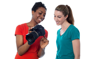 Women viewing pictures in the camera