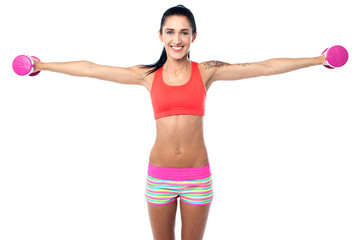 Fitness woman lifting dumbbells