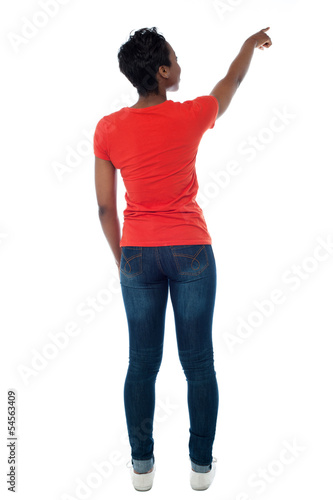 Casual african woman pointing at something