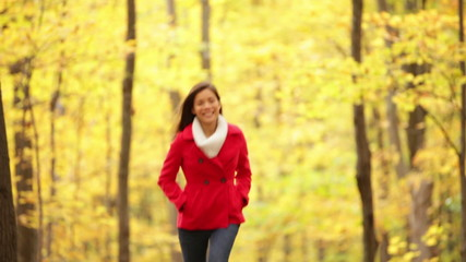 Fall woman running in autumn forest