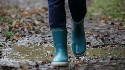 Autumn fall rainboots woman walking in puddle