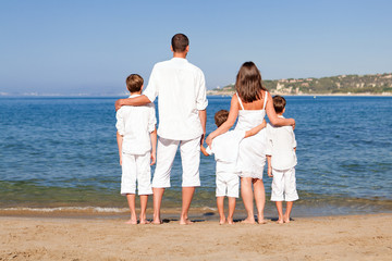 Young family with three kids on vacation