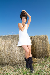 Girl with big hair over field background