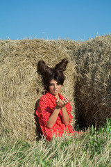 Girl with devil image in countryside