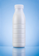 White Plastic bottle of milk on a blue background