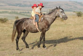 boy riding a horse on farm outdoor portrait