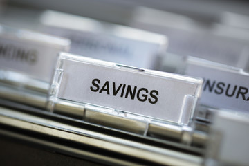 Savings heading in filing cabinet