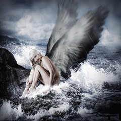 Sexy blond woman with angel wings