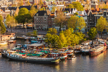 Group of houseboats in Amsterdam during sunset