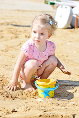 little girl in sand