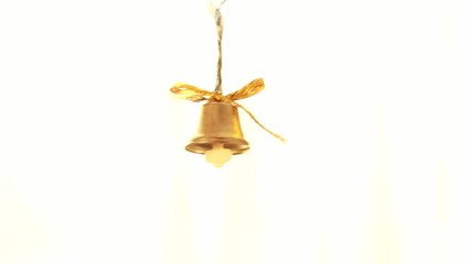 small golden bell on white background