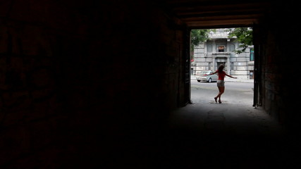 girl dancing in the alley