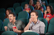 Friends in cinema. Two friends watching movie at the cinema with