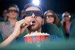 Men at the cinema. Excited young men in glasses watching movie a