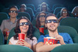 People at the cinema. Cheerful people in three-dimensional glass