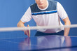 Table tennis player. Confident young men playing table tennis