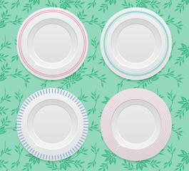 4 realistic empty plates on tablecloth