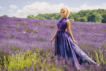 Beautiful woman in lavender fields
