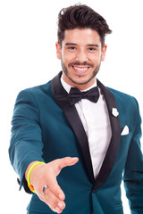 Portrait of happy smiling businessman giving hand for handshake,