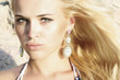 beautiful blond young woman. stone background