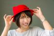 Thai girl is wearing her red hat showing cute gesture