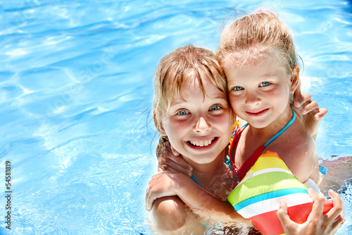 Kids with armbands in swimming pool.