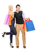 Man and female standing close together and holding shopping bags