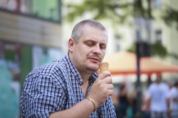 Man with ice cream on a bench