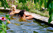 Two women are swimming in the pool at their summer cottage