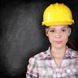 Construction worker woman on blackboard texture