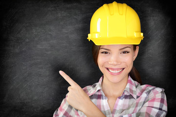 Female construction worker or engineer showing